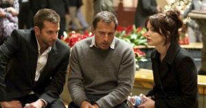 "Director David O. Russell talks with actors Bradley Cooper and Jennifer Lawrence on the set of ""Silver Linings Playbook"""